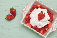 Strawberries and cream. Dish of strawberries and cream Stock Photography