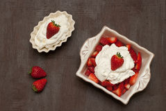 Strawberries with cream. Dish of strawberries and cream Royalty Free Stock Photos