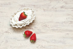 Strawberries with cream. Dish of strawberries and cream Royalty Free Stock Photography