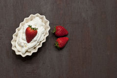Strawberries with cream. Dish of strawberries and cream Stock Photography