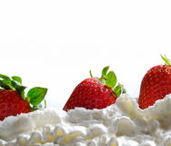 Strawberries with cream isolated. Whole three strawberries and cream isolated Royalty Free Stock Photography
