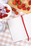 Strawberries cream, summer fruits, recipe book, copy space Stock Photo