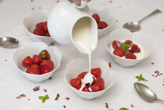 Strawberries and cream on white linen Royalty Free Stock Images