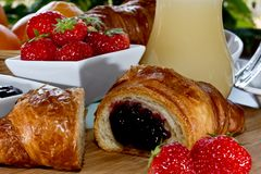 Strawberries croissant;  breakfast Stock Photography