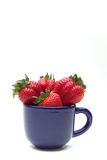 Strawberries in a cup. Organic strawberries in a blue mug Royalty Free Stock Image