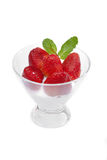 Strawberries in a cup with cream of milk Stock Image