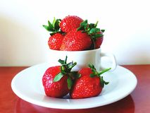 Strawberries in a cup royalty free stock photo