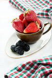 Strawberries in cup over light background Royalty Free Stock Photography