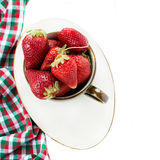 Strawberries in cup over white background Royalty Free Stock Photos