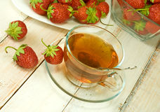 Strawberries and a cup of tea Stock Images