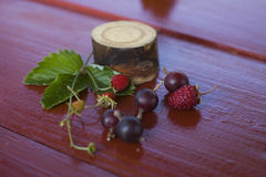 Strawberries and currants.  still life. Strawberries and currants on the table. still life. Macro photo Stock Image