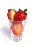 Strawberries cut in a shot Stock Image