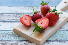 Strawberries on cutting on the vintage table Royalty Free Stock Image