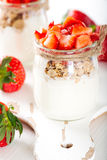 Strawberries desert with cream and cereals Stock Photos