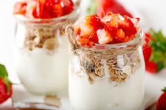 Strawberries desert with cream and cereals Stock Photo