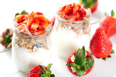 Strawberries desert with cream and cereals Royalty Free Stock Photos