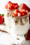Strawberries desert with cream and cereals Royalty Free Stock Images