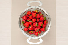 Strawberries, design, table, food, fruit, vitamins, healthy, diet, summer, tasty. Metal basket with strawberries on a wooden table Royalty Free Stock Photo