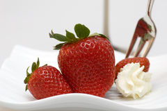 Strawberries with dessert fork Stock Image