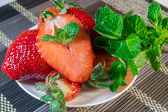 Strawberries dessert. Strawberries with mint on a plate stock images