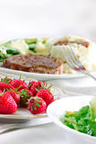 Strawberries and dinner Stock Photography