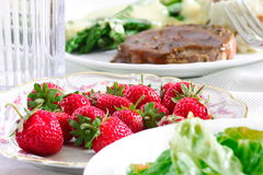 Strawberries and dinner background Stock Photo