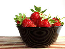 Strawberries on dish Stock Images