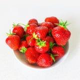 Strawberries on dish Stock Photos