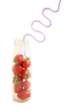 Strawberries and drinking straw Stock Images