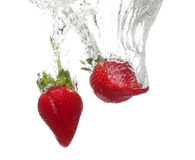 Strawberries drop to water Stock Photography