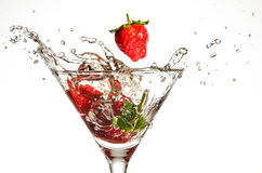 Strawberries Dropping in Martini Glass Stock Image