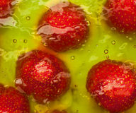 Strawberries embedded in jelly Stock Image
