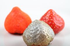 Strawberries expressing difference Royalty Free Stock Image
