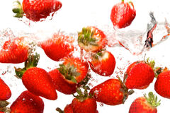 Strawberries falling in water Royalty Free Stock Photos