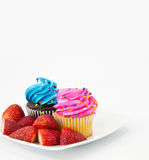 Strawberries with Festive, Colorful Cupcakes Royalty Free Stock Photos