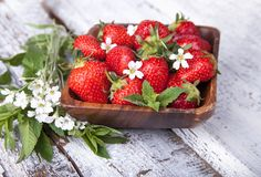 Summer berries on a wooden background stock images