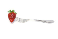 Strawberries on a fork Stock Photos