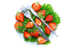 Strawberries with fork and knife . Isolated Royalty Free Stock Photo