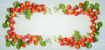 Strawberries frame on wooden background, top view, banner Royalty Free Stock Images