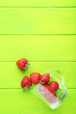 Strawberries. Fresh strawberries on green wooden table Royalty Free Stock Photography