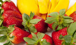Strawberries and fresh mango Royalty Free Stock Photography