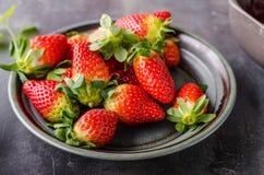 Strawberries fresh pick up Stock Photography