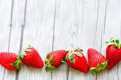 Strawberries. Fresh strawberries on wooden background stock photos