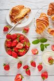 Strawberries, freshly baked croissants and cream Stock Image