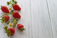 Strawberries. Freshly picked strawberries on a white wooden background Stock Photo