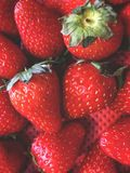 strawberries, fruit arrangement in a hazy order, in a container with a red background stock photos