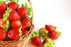 Strawberries and fruit basket Stock Images
