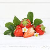Strawberries fruits strawberry leaves square on wooden board Stock Photo
