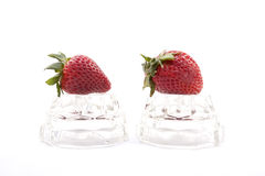 Strawberries on glass. Stock Images