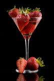 Strawberries and glass Stock Photography